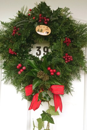 Image of christmas-wreath-on-white-front-door