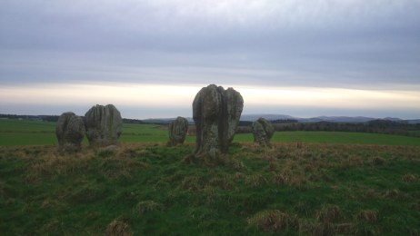 Image of duddo-stone-circle-of-5-stones-standing-on-a-hill-with-mountains-in-background