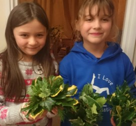 Image of girls-with-evergreen-table-centres