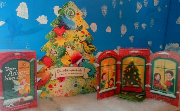 3-boxes-of-advent-teabags-2-square-1-christmas-tree-shaped-in-front-of-painted-snow-scene