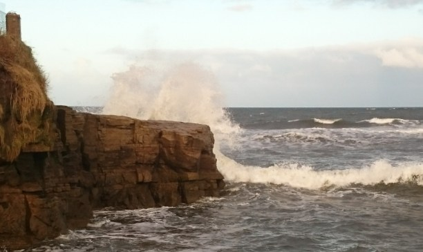 Image of wave-crashing-over-rocks