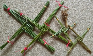 Image close-up-of-several-brigids-crosses-made-from-fresh-reeds