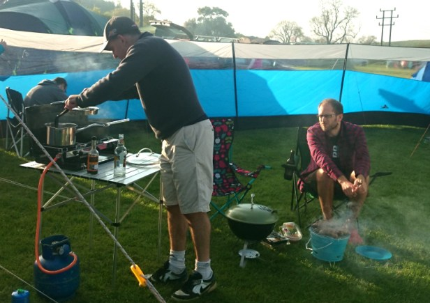 man-cooking-on-camping-stove-and-man-cooking-on-barbecues
