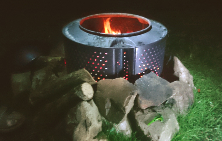 Image of night-time-shot-of-fire-in-old-washing-machine-drum