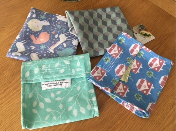 Image of 4 multicoloured fabric wraps and pouches
