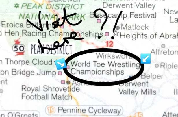 Image of close-up section of map with circle and arrows highlighting toe wrestling championships and hand written note visit here