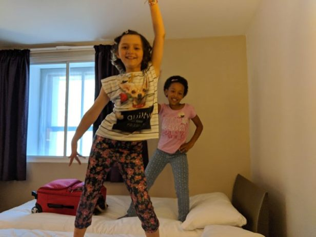 Image of two girls dancing in a hotel room