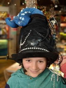 Image of girl in black pirate hat with octopus tentacle on