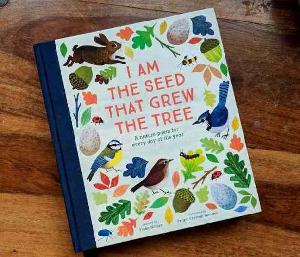 Image of illustrated book lying on table, titled I am The Seed That Grew The Tree