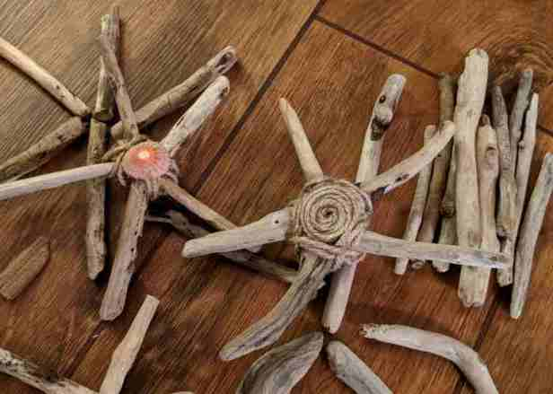 Image of 2 driftwood stars with small driftwood sticks behind