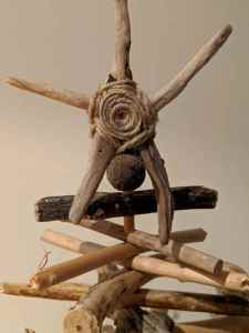 Image of homemade string and driftwood star at the top of a driftwood tree
