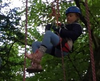 girl-in-climbing-harness-in-tree-2