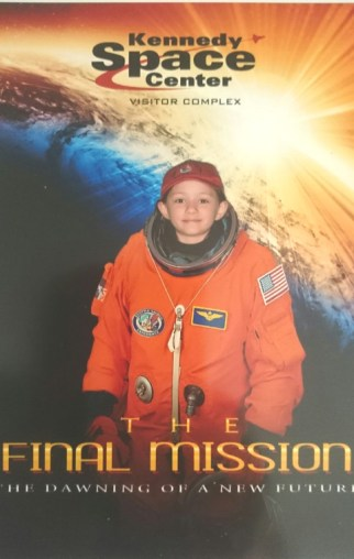 Girl in orange space suit