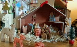 wooden-advent-crib-with-nativity-animals-and-figurines-inside-on-straw-bedding