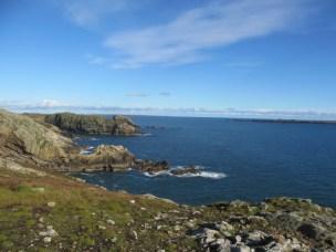 View of sea from grassy cliffs Skomer Island UK