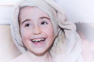 child with towel