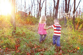 kids playing in woods