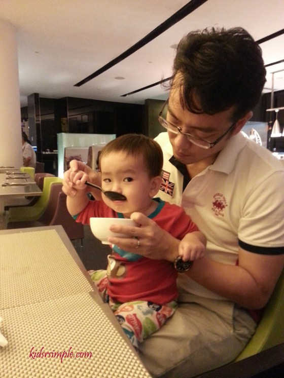 HIs favourite place to drink soup - on his Papa's lap
