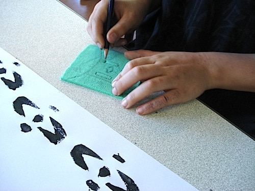 Students Working on their Adinkra Symbols- Kid World Citizen