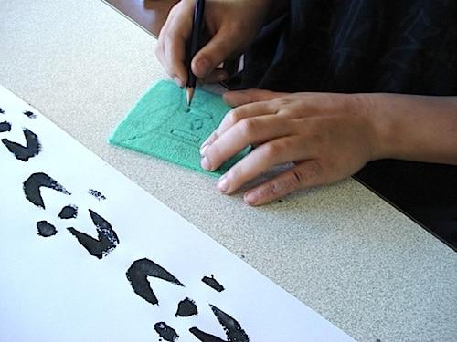 Students Working on their Adinkra Symbols- Kid World Citizen