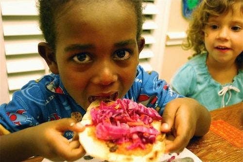 Enjoying Salvadoran Pupusas- Kid World Citizen