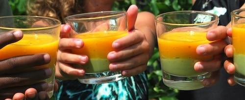 Kids Drinking Ethiopian Layered Avocado Mango Drink- Kid World Citizen