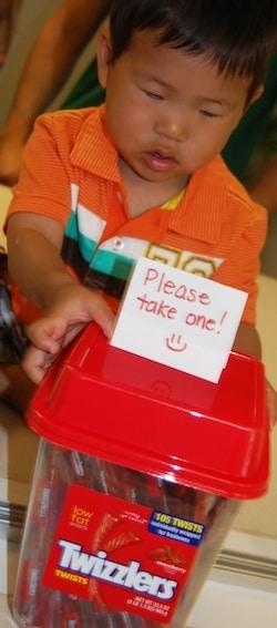 Kids Volunteering Handing Out Candy- Kid World Citizen