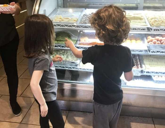 Kids looking at Indian sweets in Queens