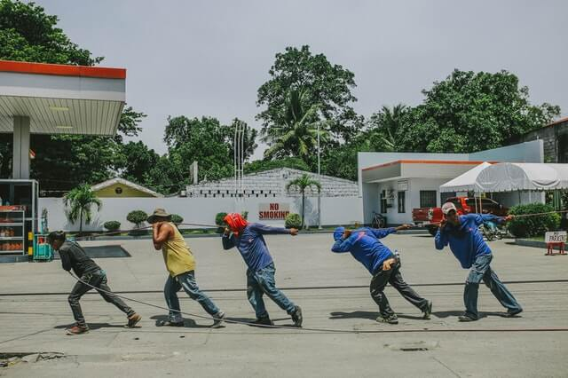 https://www.pexels.com/photo/five-men-pulling-black-rope-942540/