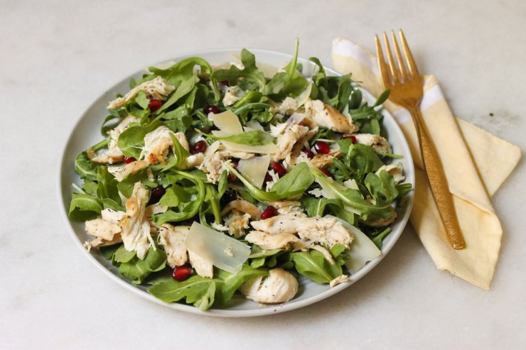 Lemon arugula salad with chicken and parmesan shavings