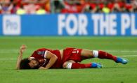 Soccer Football - Champions League Final - Real Madrid v Liverpool - NSC Olympic Stadium, Kiev, Ukraine - May 26, 2018 Liverpool's Mohamed Salah on the floor after sustaining an injury REUTERS/Kai Pfaffenbach