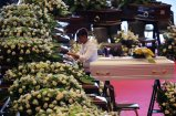 A person cleans the coffin before the state funeral of the victims of the Morandi Bridge collapse, at the Genoa Trade Fair and Exhibition Centre in Genoa, Italy August 18, 2018. REUTERS/Stefano Rellandini