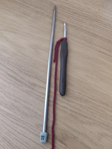 starting the crochet cast on with a knitting needle and crochet hook
