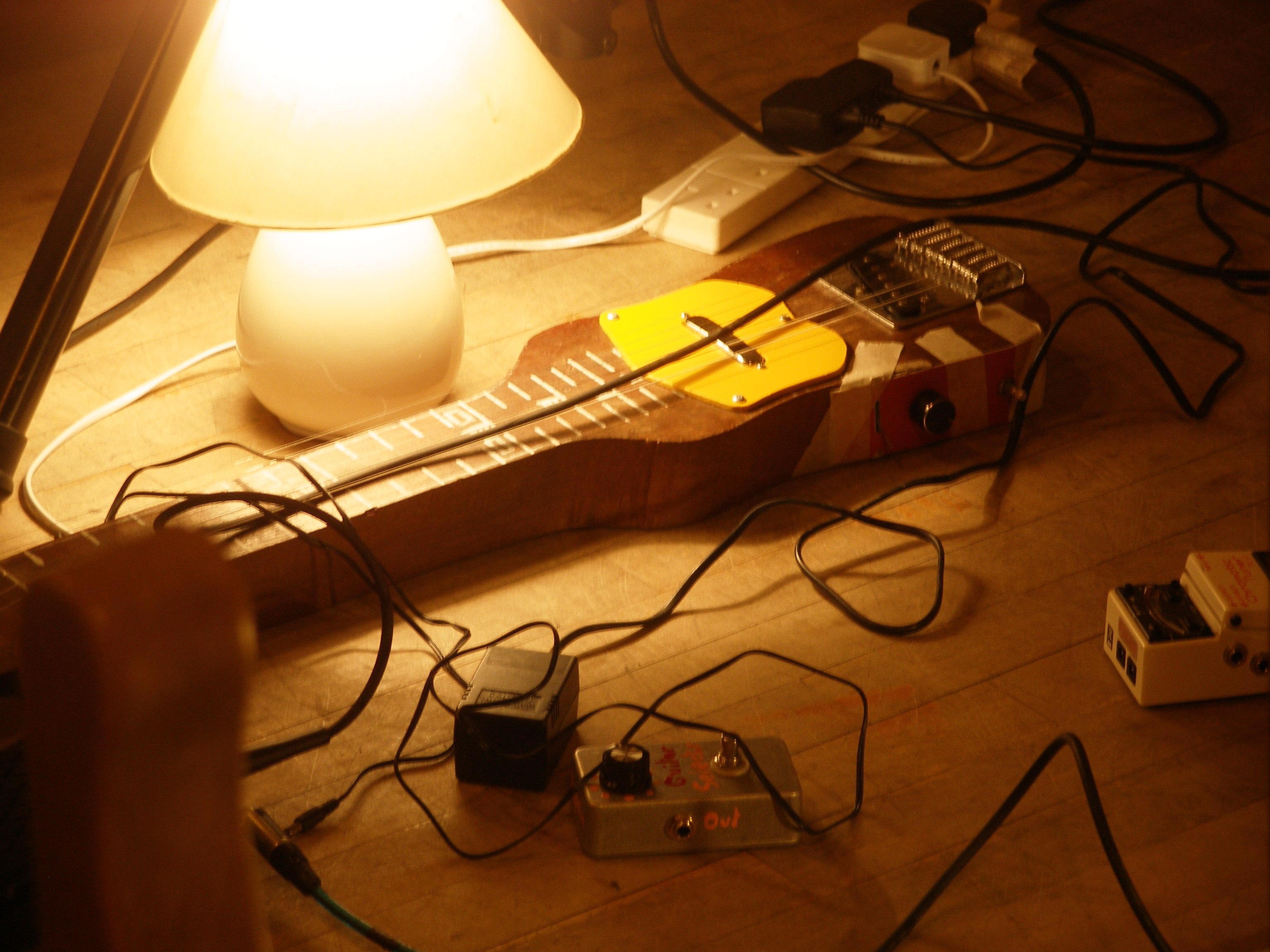 John's handmade lap steel basks in the lamp light!