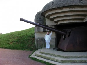 HK in 2003 standing by one of the German concrete pillboxes and heavy gun still remaining to this day.