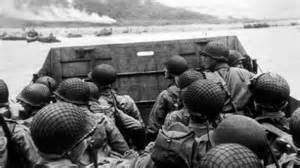 Troops on landing craft waiting to disembark into the sea to wade ashore.