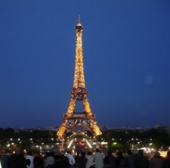 The iconic Tour Eiffel ablaze with lights.