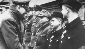 Hitler presenting the Iron Cross to the boys of the Hitler Youth on his birthday.