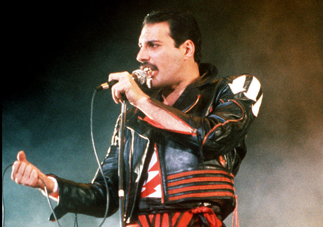 "FILE - In this 1985 file photo, singer Freddie Mercury of the rock group Queen, performs at a concert in Sydney, Australia. Queen guitarist Brian May says an asteroid in Jupiter's orbit has been named after the band's late frontman Freddie Mercury on what would have been his 70th birthday, it was reported on Monday, Sept. 5, 2016. May says the International Astronomical Union's Minor Planet Centre has designated an asteroid discovered in 1991, the year of Mercury's death, as ""Asteroid 17473 Freddiemercury."" (AP Photo/Gill Allen, File)"