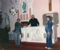 Michael Haugh, Fr Michael Hillery and Michael Corry installing the cararra marble altar, Jan 1992
