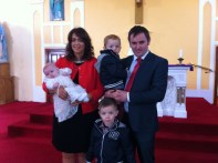 Megan Louise Kelly with their parents Audrey and Gerard and her brothers on her baptism day.