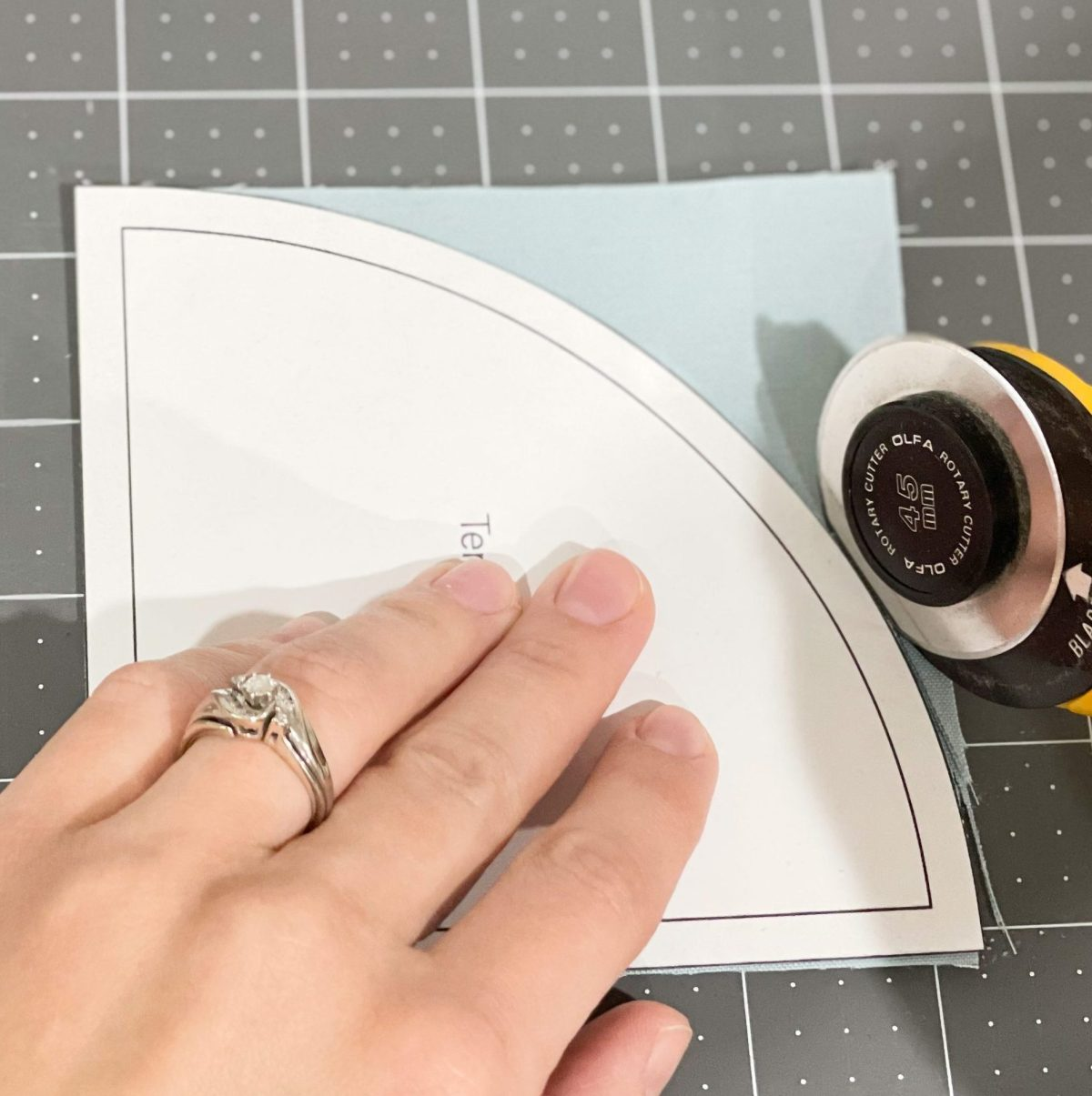 How to sew curves: Cutting along the curved template.