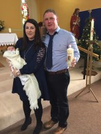 Lorcan O'Halloran with his parents Angela and Padraig on his baptism day.