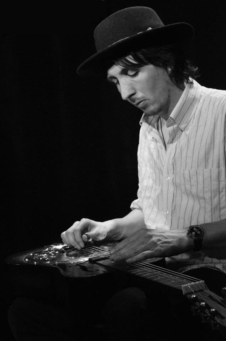 Tom Portman on guitar.