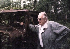 Year 2000 photo of Garnet Kranz standing beside the REO truck he learn to drive many years before. Private Collection.