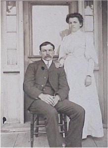 couple unknown posing on front porch
