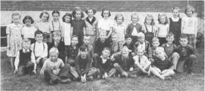 The Class of '49 Junior Room - Killaloe Public School. This photo was submitted to the Eganville Leader for publication by Mrs. Pearl Murack. Betty Mullin Collection.Teacher: Mrs. Edna Zummach (not shown). Back row, left to right, Jean Zummach, Janet Kuehl, Jean Kuehl, Norma Noack, Maxine Nass, Luella Kranz, Judy Poland, Caroline Drake, Edith Welk, Veneta Burke, Lenore Kuehl, Doreen Etmanskie, Pearl Burke and Margaret Schleen; centre row, left to right, Garry Layman, Billy Buder, David Burke, Ronald Getz, Melvin Kinder, Ronald Weber, Wallace Kuehl, Reggie Kuehl, Owen Kuehl, Mark Porter, Kenneth Buder and Allan Kranz; front row, left to right, Stanley Kuehl, Keith Kuehl, Hubert Weber, Garry Etmanskie, Boyd Manwell and Douglas Manwell.