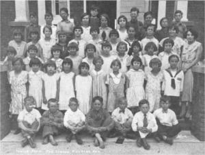 Photo of Killaloe Public School, Junior Room, 1930. Pearl Murack Collection.First row, left to right, seated, Clarence Smith, Berthold Bloedow, Nelson Getz, Meldron Nass, Russell Wallbeck, Harold Chatsick and Erwin Schleen; second row, left to right, Evelyn Burke, Elsie Wallbridge, Jean Briscoe, Maisee Buder, Christina Weckworth, Phyllis Ristow, Ardella Schleen, Ada Hamilton, Rachel Hein and Erna Okum; third row, left to right, Myrtle Okum, Ardella Felhaber, Aldean Boland, Beatrice Kosmack, Pearl Schroeder, Iona Briscoe, Edna Schroeder, Mabel Yourth, Eileen Hein, Ethel Bloedow and Miss Lavis, Teacher; fourth row, left to right, Elaine Kosmack, Edith Kosmack, Violet Folkard, Leona Weckworth, Katie Kuehl, Ruth Wallbridge, Elaine Chatsick, Gertrude Okum, Eileen Laymond and Elsie Nass; fifth row, left to right, Gerald Hein, Daniel Felhaber, Ralph Ristow, Florence Layman, Clifford Lisk, Rhona Schroeder, Elga Chatsick, Clifford Schroeder, Harold Lisk, Albert Yourth and George Hein.