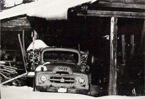 old truck loaded with slabs of wood. wcmd