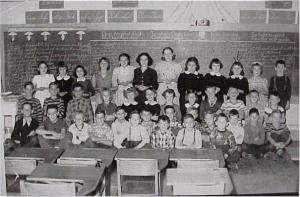 St. Andrew's class photo 1953. Killaloe Millennium Museum Exhibit.Back row, left to right, Margaret Lorbetskie, Lorraine Holly, Anne Sullivan, Myrtle Gutoskie, Theresa Ruddy, Ann O'Malley, Ann Lorbetskie, Geraldine Etmanskie, Patsy Holly, Dianne Lessard, Marie Yolkowskie, Jimmy Lynch; 2nd row, left to right, Dobson twins, Cecil Guay, Mary Gutoskie, Helen Shulist, Sylvia Bochart, Camille Harrington, Dennyse Hazelton, Richard Fleurie, Alphonse Prince, Donald Manders, Clifford Olsen; 1st row, left to right, Mickey Dooner, Kevin Holly, George Olsen, KeiTh Stack, Leonard Andrechek, Kenny Bozak, unknown, unknown, Harold Sullivan, Mike Lessard, Leonard Coulas, Pat Sullivan; front row, left to right, Billy Lorbetskie, Malcolm Finnucane, Basil Ruddy, Garry O'Malley.